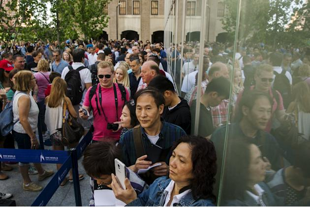 Visitors stand in line as they wait to enter the newly opened One World Observatory in the Manhattan borough of New York