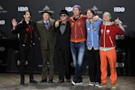 Current and former members of the Red Hot Chili Peppers appear in the press room before induction into the Rock and Roll Hall of Fame induction ceremonies Friday, April 13, 2012, in Cleveland. From left: , Anthony Kiedis, Jack Irons, Cliff Martinez, Chad Smith, Josh Klinghoffer and Flea. (AP Photo/Amy Sancetta)