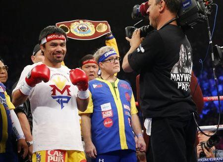 Pacquiao of the Philippines arrives in the ring to face Mayweather Jr. of the U.S. ahead of their welterweight title fight in Las Vegas