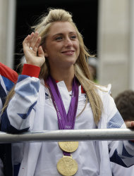 Britain's cyclist Laura Trott waves to the crowds as the Team GB Olympic and Paralympic teams parade in the streets of London, Monday, Sept. 10, 2012. Our Greatest Team Parade, the procession of athletes, celebrates the achievements of British Olympians and Paralympians at the London 2012 Games. (AP Photo/Lefteris Pitarakis)