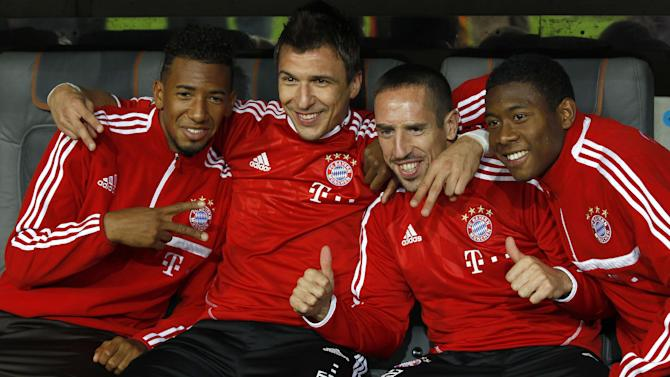 Munich's Jerome Boateng, from left, Mario Mandzukic of Croatia, Franck Ribery of France and David Alaba of Austria pose for media  prior to the German soccer cup second round match between FC Bayern Munich and Hannover 96, in Munich, southern Germany, Wednesday, Sept. 25, 2013