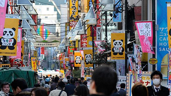 5. (Tied) Japan Highest income tax rate: 50%  Average 2010 income: $53,200   Japan is the only Asian country to make the list of the top 10. Its top tax rate of 50 percent is more than double Asia's average rate of 23 percent.   The country's highest income tax rate is broken into two parts with a marginal rate of 40 percent, which comes into effect at around $217,000, plus an additional 10 percent municipal tax. Social security taxes range from 0.6 percent for employment insurance to 5 percent for health insurance capped at $700 a month. With Japan's rapidly aging society, those 40 and over are also required to pay a nursing care insurance of 0.8 percent, capped at $110 a month. Other notable taxes include capital gains for stock transactions at 20 percent.   Japan's tax revenue is the fifth lowest among OECD members, and the country has been dealing with its growing debt problems. Prime Minister Yoshihiko Noda — Japan's sixth leader in the past five years — has seen his popularity plummet in opinion polls after proposing plans to double the country's sales tax to 10 percent in 2014. In 2011, the tax burden for all Japanese families increased due to higher employee and employer social security contributions and a cut in tax allowances related to children, according to the OECD.   Pictured: Ueno Station in Tokyo  Photo: Kazuhiro Nogi | AFP | Getty Images