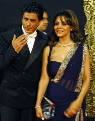 "In this Monday, Nov. 12, 2012 photo, Bollywood star Shah Rukh Khan, poses with his wife Gauri Khan during the premiere of his film ""Jab Tak Hai Jaan"" or ""As long as I Am Alive"" in Mumbai, India. Bollywood stars turned out in strength at the premiere of the movie for a final homage to movie mogul Yash Chopra, who died last month days after finishing the film. Chopra was known as the ""King of Romance"" for creating classic love stories that were immensely popular. (AP Photo/Rafiq Maqbool)"