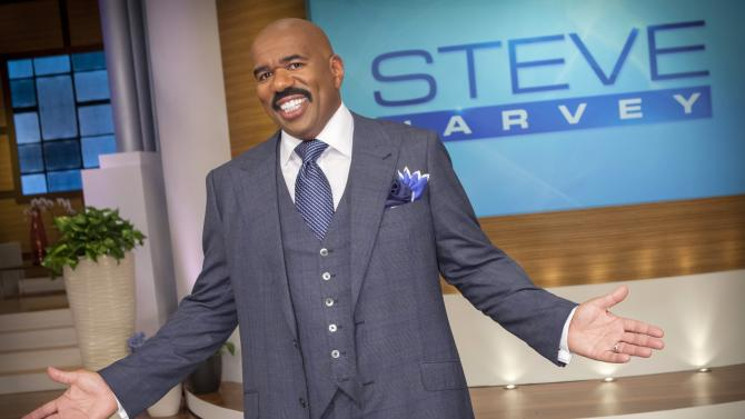 """In this August 2012 photo provided by NBC, host Steve Harvey stands on the set of his new talk show """"The Steve Harvey Show,"""" in Chicago. The veteran comic, whose new show gets a jump on the fall season Tuesday, Sept. 4, 2012, was first approached about a show three years ago, when his first book, """"Act Like a Lady, Think Like a Man,"""" was on the best-seller lists. (AP Photo/NBC, Chuck Hodes)"""