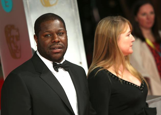 Director Steve McQueen and his wife Bianca Stigter pose for photographers on the red carpet at the EE British Academy Film Awards held at the Royal Opera House on Sunday Feb. 16, 2014, in London. (Pho