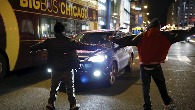 Protesters demonstrate in Chicago in response to fatal shooting of Laquan McDonald