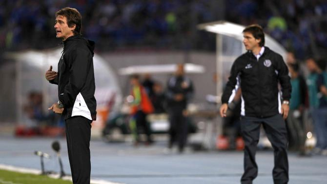 Argentina's Lanus head coach Guillermo Barros Schelotto, and his twin Gustavo, shouts to his players during their Copa Sudamericana soccer match against Chile's Universidad de Chile in Santiago