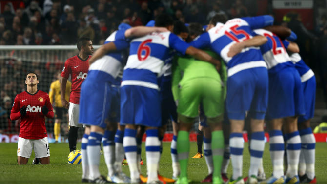 Manchester United's Hernandez prays as the Reading team huddles together before their FA Cup soccer match at Old Trafford in Manchester