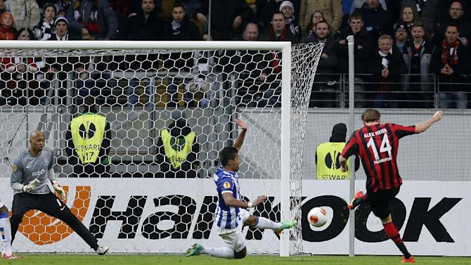 Frankfurt's Alexander Meier , right, scores his side's third goal during a Europa League round of 32 second leg soccer match between Eintracht Frankfurt and FC Porto in Frankfurt, Germany, Thursday, Feb. 27, 2014