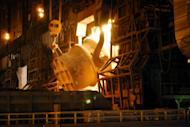 A converter process is seen at Nippon Steel's Kimitsu iron mill plant in Kimitsu city, Chiba prefecture. Japan's biggest steelmakers likely suffered a plunge in recurring profit of up to 80 percent in the April-June quarter as competition with Chinese rivals drove prices down, according to a report