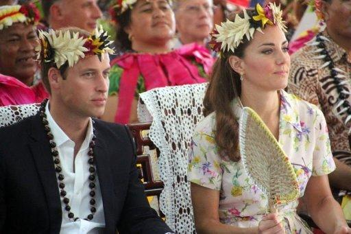 Prince William (L) and his wife Catherine attend a farewell ceremony in Tuvalu on September 19, 2012. A Swedish celebrity magazine published pictures of Catherine sunbathing topless, a day before a Danish publication was to do the same despite fury from the royals.