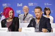"Director Lana Wachowski and actor Tom Hanks speak onstage at the ""Cloud Atlas"" Press Conference during the 2012 Toronto International Film Festival on September 9. ""Cloud Atlas"" co-director Lana Wachowski this week publicly embraced her gender switch from Larry for the first time -- with bright pink dreads"