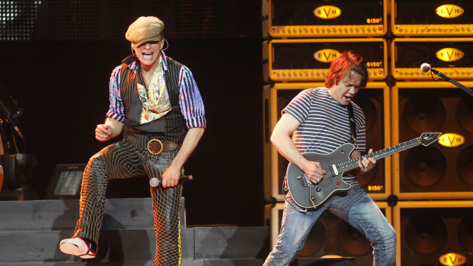 FILE - In this March 1, 2012 file photo, David Lee Roth, left, and Eddie Van Halen perform during a Van Halen concert at Madison Square Garden in New York. A source familiar with the band's summer tour who was not authorized to speak publicly confirms that some of Van Halen's long-scheduled performances this summer will be postponed. The group's website lists tour dates through June 26. (AP Photo/Jason DeCrow, File)