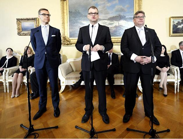 New Finnish Prime Minister Juha Sipila, centre, Finance Minister Alexander Stubb, left  and Foreign Minister Timo Soini  his cabinet attend a press conference in Helsinki, Finland on Friday  May 29, 2