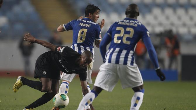 Academica's Cassama tries to control ball near Porto's Pesqueira and Mangala during their Portuguese Premier League soccer match at the Coimbra city stadium in Coimbra
