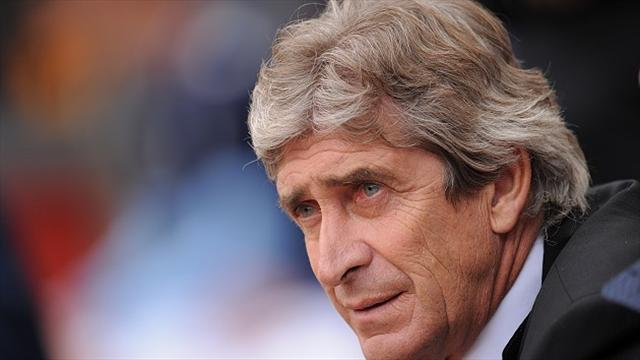 Football - Pellegrini puzzled by defeat
