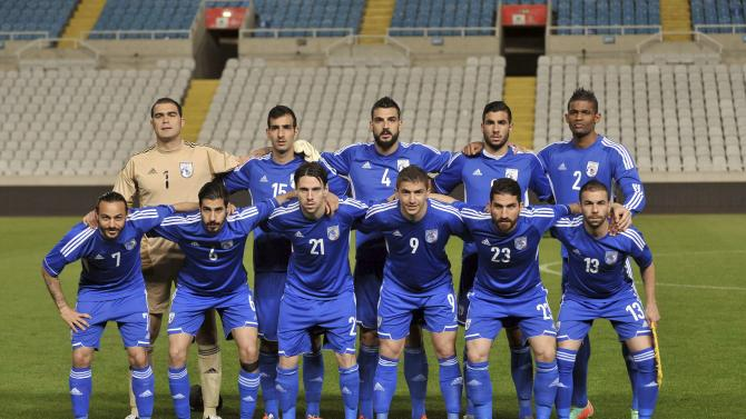 Cyprus' national soccer team pose for a group photo before their match against North Ireland during their international friendly match at Gsp Stadium