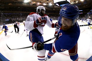 Montreal's P.K. Subban gets tangled up with Brad Richards during Game 6 of the East final at Madison Square Garden on May 29, 2014. (Getty)