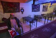 Zabulon Simantov, an Afghan Jew, sits inside his cafe in Kabul November 5, 2013. REUTERS/Omar Sobhani