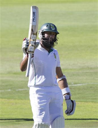 South Africa's Amla celebrates scoring a half century during the third day of the second cricket test match against Australia in Port Elizabeth