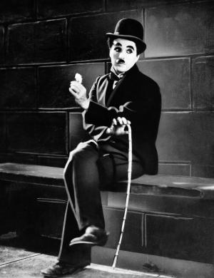 """FILE - In this 1931 film image originally released by United Artists, actor Charlie Chaplin is seen in the silent film """"City Lights.""""  A new musical """"Chaplin,"""" depicting the life of film icon Charlie Chaplin, will open on Broadway on Monday, Sept. 10, 2012 at the Barrymore Theatre in New York. (AP Photo, file)"""