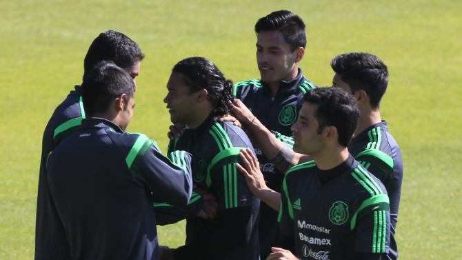 Pena jokes with team mates during a practice session in Mexico City