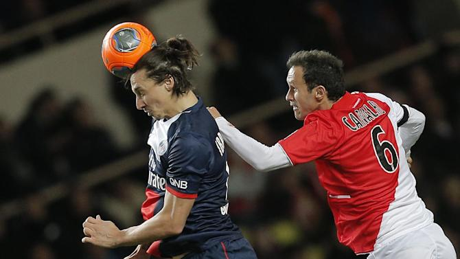 Paris Saint Germain's Zlatan Ibrahimovic of Sweden, left, challenges for the ball with Monaco's Ricardo Carvalho of Portugal during their French League One soccer match, in Monaco stadium, Sunday, Feb. 9 , 2014