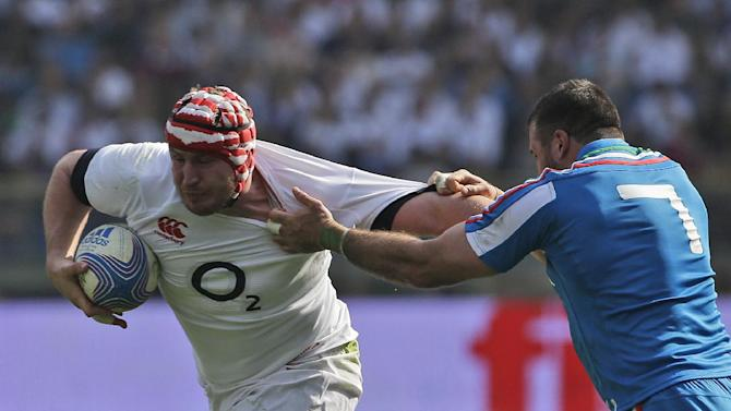 England's Ben Morgan, left, and Italy 's Robert Barbieri compete for the ball during a Six Nations international rugby union match between Italy and England, in Rome, Saturday, March 15, 2014. Owen Farrell accounted for 22 points and Mike Brown added two tries as England stated its case for the Six Nations title with a convincing 52-11 win over Italy on Saturday at the Stadio Olimpico
