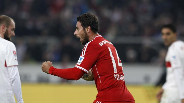 Bayern Munich's Pizarro celebrates goal against Stuttgart during German Bundesliga soccer match in Stuttgart