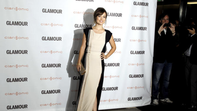 "Actress Olivia Wilde arrives at a screening for ""Glamour Reel Moments"" in Los Angeles, Monday, Oct. 24, 2011. ""Glamour Reel Moments"" is a short film series that turns personal stores submitted by Glamour readers and turns them into short films. (AP Photo/Matt Sayles)"