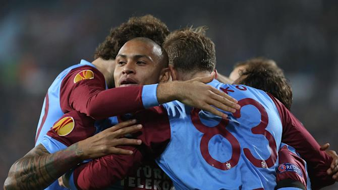 Trabzonspor's Janko, 83, celebrates his goal with Paulo Henrique, second left, and other teammates during their Europa League Group J soccer match with Legia in Trabzon, Turkey, Thursday, Oct. 24, 2013. (AP Photo