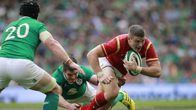 Wales Scott Williams, right, is tackled by Ireland's Johnny Sexton, left, during their international rugby union match at the Aviva stadium, Dublin, Ireland, Saturday, Aug. 29, 2015.  (AP Photo/Peter Morrison)