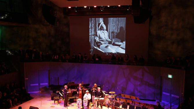 Bill Cosby, second from right, plays with Pete Escovedo, right, and John Santos, third from left, during the opening night concert of the SFJAZZ Center Wednesday, Jan. 23, 2013 in San Francisco. The 700-seat, specially designed concert hall nestled in the heart of the city's arts district attracted a crowd of hundreds with a high-energy, inaugural celebration emceed by Bill Cosby. Billed as the first freestanding building in the West built for jazz performance and education, the center opened Wednesday after raising more than $60 million over more than a decade to build a home for SFJAZZ, the nonprofit that puts on the city's jazz festival. (AP Photo/Eric Risberg)