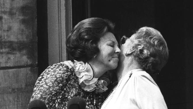 FILE - In this April 30, 1980 file photo, Princess Juliana, just after her abdication, kisses her eldest daughter Queen Beatrix, left, on the balcony of the Royal Palace in Amsterdam, Netherlands. The Dutch Queen Beatrix announces she is to abdicate in favor of Crown Prince Willem Alexander during a nationally televised speech Monday, Jan. 28, 2013. Beatrix, who turns 75 on Thursday, has ruled the nation of 16 million for more than 32 years and would be succeeded by her eldest son, Crown Prince Willem-Alexander. (AP Photo/ Ferry van Groen, File)