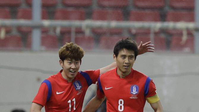 South Korea's Son Heungmin, left, celebrates after scoring the second goal of his team with teammate Koo Jacheol during a friendly match at Georgios Karaiskakis stadium against Greece in Piraeus port, near Athens, Wednesday, March 5, 2014