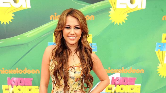 "Former ""Hannah Montana"" star Miley Cyrus looked a bit out of step on the orange carpet at Nickelodeon's 24th Annual Kids' Choice Awards, wearing a long floral-print dress with a train when most of her peers opted for shorts or short skirts. Nickelodeon's 24th Annual Kids' Choice Awards"