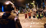 Protestors clash with riot squad officers on a street near Maracana stadium in Rio de Janeiro, Brazil on June 30, 2013. The demonstrators responded to calls on social media to turn out to back the national squad but also to protest the country's inadequate public services -- a key gripe at the core of two weeks of demonstrations that have rocked the South American giant