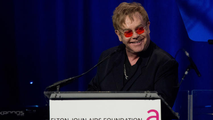 Elton John appears on stage at his AIDS Foundation's 11th annual Enduring Vision benefit on Monday, Oct. 15, 2012  in New York.  (Photo by Charles Sykes/Invision/AP)