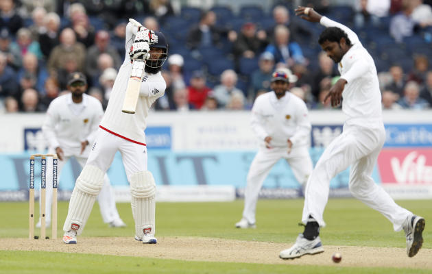 England's Moeen Ali hits a four