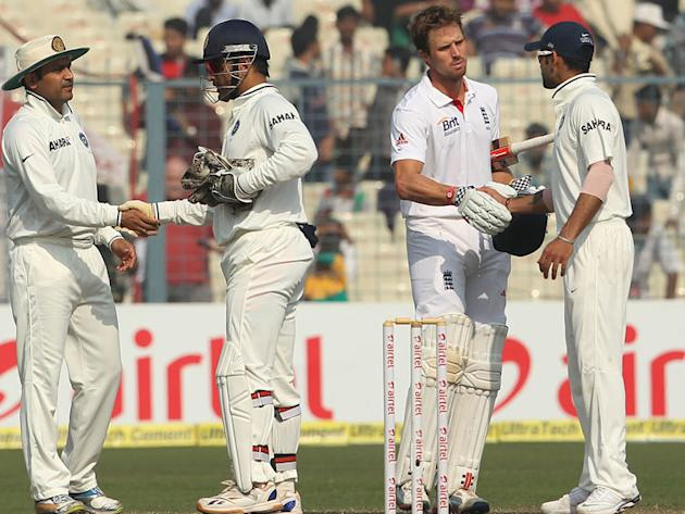 Virat Kohli shakes hands with Nick Compton after England beat India in the Eden Gardens Test match at Kolkata.