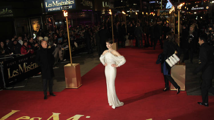 Anne Hathaway arrives on the red carpet for the World Premiere of 'Les Miserables' at a central London cinema in Leicester Square, Wednesday, Dec. 5, 2012. (Photo by Joel Ryan/Invision/AP)