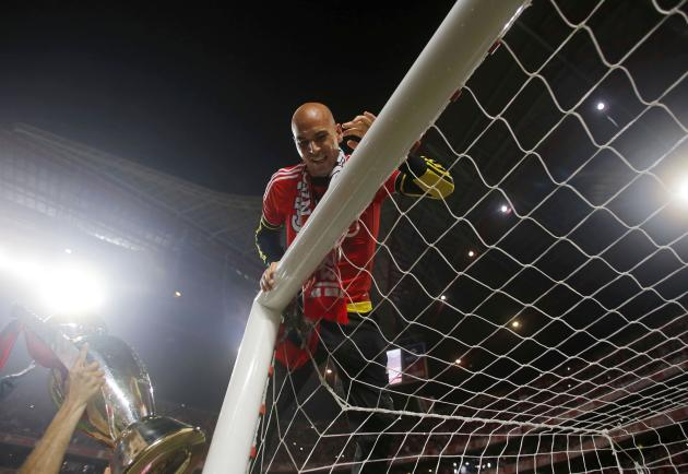 Benfica's goalkeeper Paulo Lopes waits to receive the Portuguese Premier League trophy title with Benfica coach Jorge Jesus after beating Olhanense at Luz stadium in Lisbon