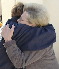 Hugging photo by Leif Skoogfors – FEMA – U.S. Government photo – public domain