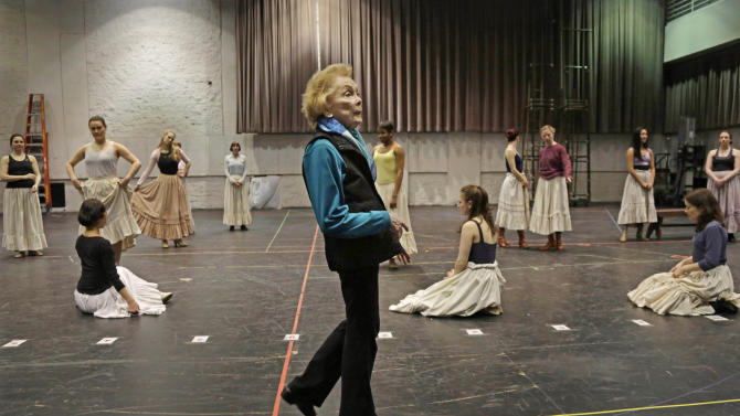 """In this April 26, 2013 photo, choreographer Gemze de Lappe confers with the pianist during a rehearsal of Rodgers and Hammerstein's """"Oklahoma!"""" at the Lyric Opera of Chicago. De Lappe first danced in """"Oklahoma!"""" in 1943 as a member of the Broadway hit's first national touring company and now 70 years later at age 91 she's choreographing a production of the musical at the Lyric. (AP Photo/M. Spencer Green)"""