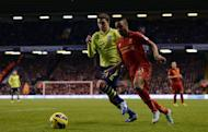 Aston Villa's defender Matthew Lowton (L) challenges Liverpool's midfielder Raheem Sterling during their English Premier League football match at Anfield in Liverpool, north-west England on December 15, 2012. Aston Villa won 3-1