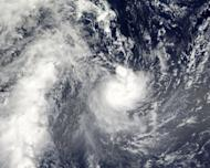 """Tropical Cyclone Evan is photographed by NASA's Aqua satellite on December 13, 2012 as it passes over Samoa. Authorities scrambled to evacuate tourists and residents in low-lying areas Sunday as a monster cyclone threatened Fiji with """"catastrophic damage"""""""