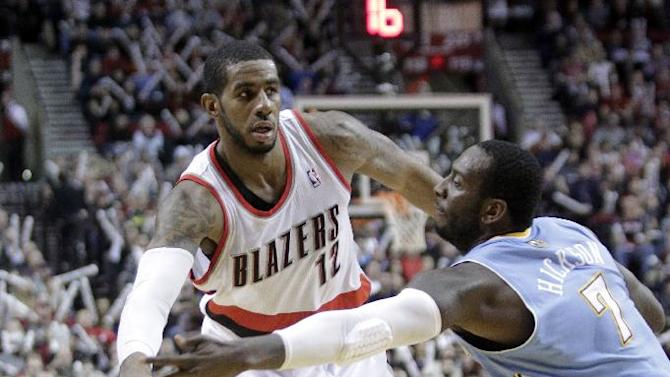 Portland Trail Blazers forward LaMarcus Aldridge, left, passes inside against Denver Nuggets center JJ Hickson during the second half of an NBA basketball game in Portland, Ore., Thursday, Jan. 23, 2014.  Aldridge scored 44 points, pulled in 13 rebounds and sank 14 free throws as they beat the Nuggets 110-105