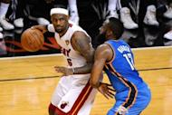 Miami Heat's LeBron James (L) and Oklahoma City Thunder's James Harden during game four of their 2012 NBA Finals on June 19. The Heat rallied to beat Thunder 104-98 to move within one victory of the NBA title