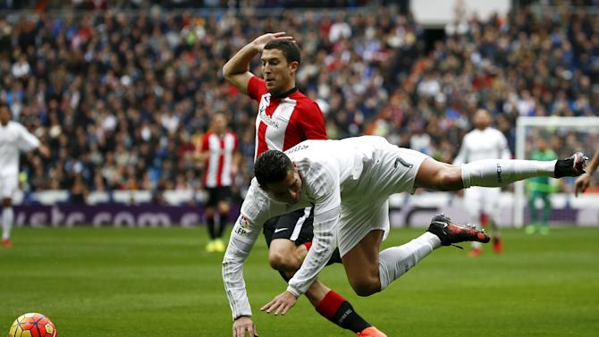 Real Madrid's Cristiano Ronaldo falls to the ground