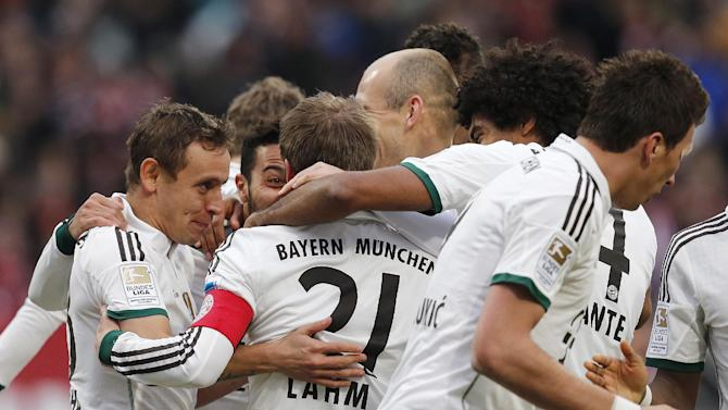 Bayern players celebrate their side's second goal during a f German first division Bundesliga soccer match between 1.FC Nuremberg and Bayern Munich in Nuremberg, Germany, Saturday, Feb. 8, 2014